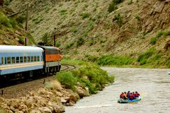 Train running near the bank. Raft and Rail Royalty Free Stock Photography