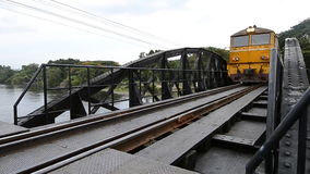 Train running on old iron bridge history railway of Kanchanaburi, thailand stock video footage