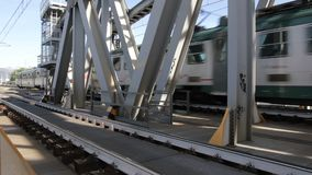 Train is running on the railway bridge. Railroad tracks on steel bridge with moving train stock video footage