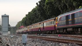 Train running on the railway in the morning. In Thailand stock footage