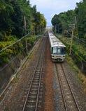 Train running on railway track. Kyoto, Japan - Nov 28, 2016. A train coming to Arashiyama Railway Station in Kyoto, Japan Stock Photography