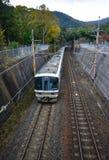 Train running on railway track. Kyoto, Japan - Nov 28, 2016. A JR train coming to Arashiyama Railway Station in Kyoto, Japan Royalty Free Stock Photography