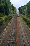 Train running on railway track. A train coming to Arashiyama Railway Station in Kyoto, Japan Royalty Free Stock Images