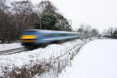 Train running in the snow Stock Photo