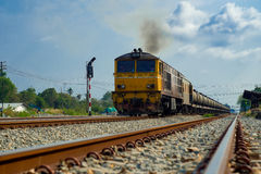 Train running on the tracks. In daytime Stock Photography