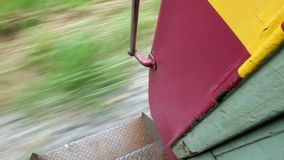 Train running view side door and side window. Footage Train running view side door and side window Thai travel for holiday stock video