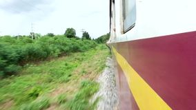Train running view side door and side window. Travel Thailand trainrunning stock video
