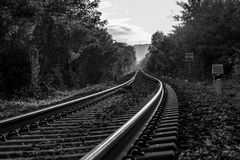 The train runs. Along the railroad tracks to infinity Royalty Free Stock Image