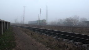 The train runs on rails in fog. Train wagons with two runs on rails in the fog stock video footage