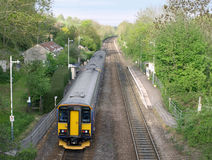 Train at a Rural Station. Train Pulling into a Small Rural Station Royalty Free Stock Photo