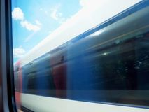 Train Rushing Past Another Train Window. A train caught in motion through another train`s window on the Southern Railway service traveling from London to Fareham royalty free stock photography