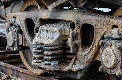 Train rusty wheels covered by salt of Baskunchak lake, Russia. It is stains on railroad carriage's surface . Close-up Stock Image