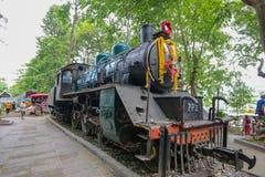 Train at Saiyoknoi Waterfall station royalty free stock photography