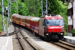 Train from Sankt Moritz arrives to Filisur station Royalty Free Stock Images