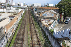 Train. Sao Paulo, SP, Brazil, 03/10/2017. Train circulates in line 8 Diamond, between sheds of old factories of the district of Lapa, west zone of Sao Paulo, SP Royalty Free Stock Photo
