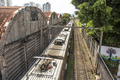 Train. Sao Paulo, SP, Brazil, 03/10/2017. Train circulates in line 8 Diamond, between sheds of old factories of the district of Lapa, west zone of Sao Paulo, SP Royalty Free Stock Images