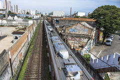 Train. Sao Paulo, SP, Brazil, 03/10/2017. Train circulates in line 8 Diamond, between sheds of old factories of the district of Lapa, west zone of Sao Paulo, SP Stock Image