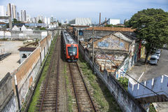 Train. Sao Paulo, SP, Brazil, 03/10/2017. Train circulates in line 8 Diamond, between sheds of old factories of the district of Lapa, west zone of Sao Paulo, SP Stock Photo