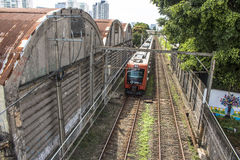 Train. Sao Paulo, SP, Brazil, 03/10/2017. Train circulates in line 8 Diamond, between sheds of old factories of the district of Lapa, west zone of Sao Paulo, SP Royalty Free Stock Photography