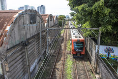 Train. Sao Paulo, SP, Brazil, 03/10/2017. Train circulates in line 8 Diamond, between sheds of old factories of the district of Lapa, west zone of Sao Paulo, SP Stock Photography