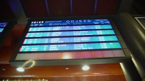 Train schedules on dynamic display at railway station, information for travelers. Stock footage stock video