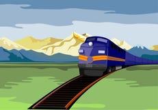 Train se déplaçant avec la montagne Photos libres de droits