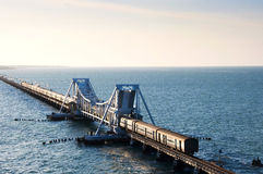 Train on a sea bridge in India stock images