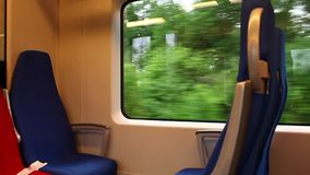 Train seats. Shooting inside the train in motion Loop Tripod stock video footage