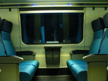 Train seats. A section with facing train seats Stock Images