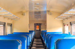 Train seats. Coach seats in an old-time passenger train car Royalty Free Stock Photography