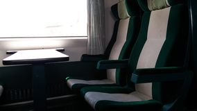 Train seats - green and gray. Window view next to train seats Stock Images