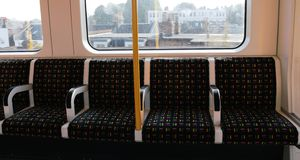 Train seats in London. Inside a train in London. Colorful comfortable empty seats in London trains stock photography