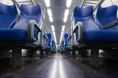Train seats. Perspective view of seats from the aisle inside a passenger train Royalty Free Stock Image