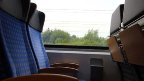 Train seats. Train travel concept - seats in interior of modern passenger car in motion stock video footage