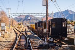 Train on several railroad tracks from the station that through the town. The train on several railroad tracks from the station that through the town royalty free stock photography