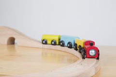 Train on sharp bend. Toy train set on table top - journey concept stock photo