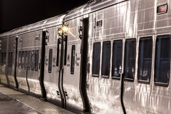 Train. Shiny commuter train cars at night royalty free stock photos