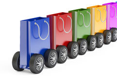Train from shopping bags with car wheels, 3D rendering Royalty Free Stock Image