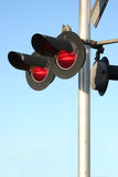 Train Signal. Red lights attached to train signal at intersection. Clear blue sky as background royalty free stock image