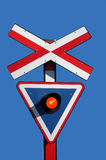 Train signal. For crossing road, with a flashing red light Stock Photography