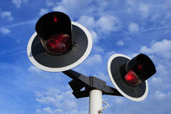 Train signal lights. Two red signal lights on blue sky Stock Photos