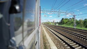 The train slowly goes after a stop. Train slowly goes after a stop stock video footage