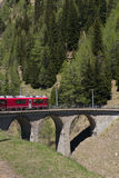 Train on a small viaduct bridge  on the Swiss Alps - 1 Stock Photography
