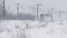 Train snow Blower cleans a railway. From snow stock video footage
