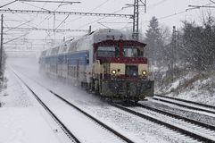 Train in the snow. Electric train in snow storm Stock Photography
