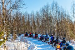 Train from snowmobiles moves along the ice Royalty Free Stock Photos