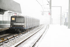 Train in snowstorm in Amsterdam N Stock Photos