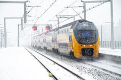 Train in snowstorm in Amsterdam N Stock Image