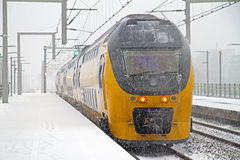 Train in snowstorm departing Stock Photography