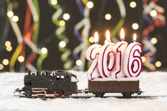 2016 train with snowy rails on colorful background Stock Photo